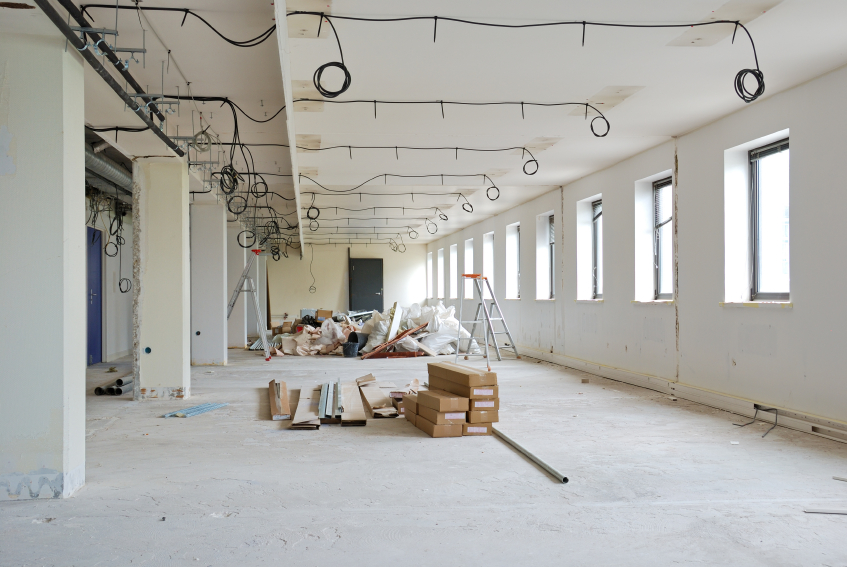 Improvement construction work in huge white office.